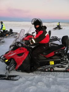 Jackie snowmobiling in Lapland